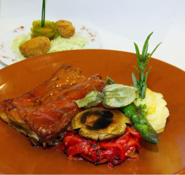 Imagen del plato que va a proponer La Buganvilla, que consiste en un Cochinillo de Segovia asado a la antigua.